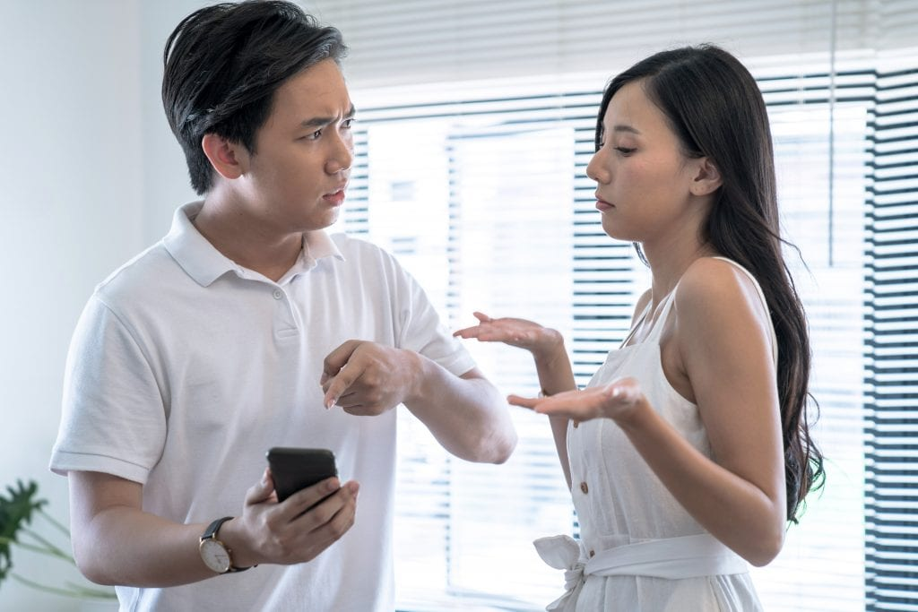 Man arguing with woman over social media posts.