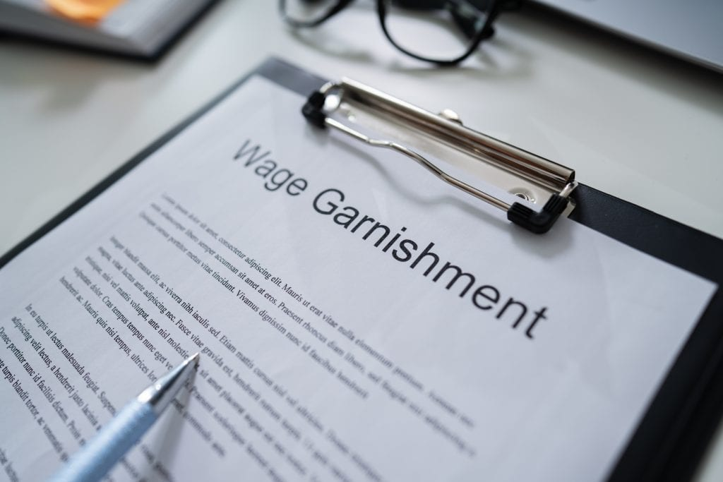 Texas court enforcement can include wage garnishment.